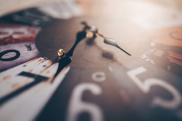 Close up of vintage clock in abstract concept.