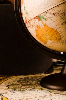 Close-up of a vintage globe on map