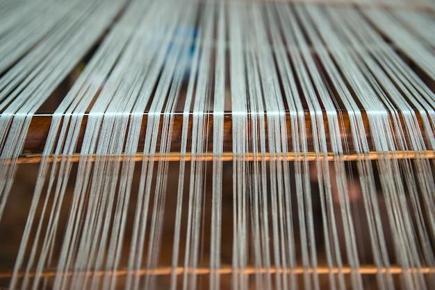 Close-up vintage meticulous silk weaving.