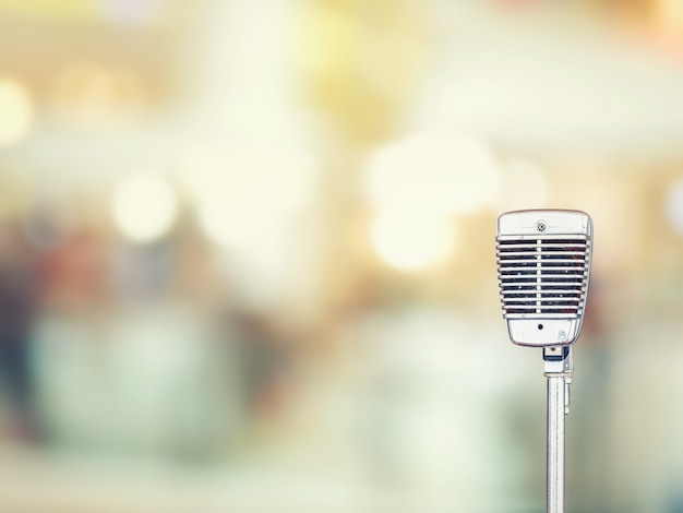 Close-up of vintage microphone in concert hall or conference room