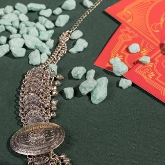 Close up vintage necklace next to tarot cards
