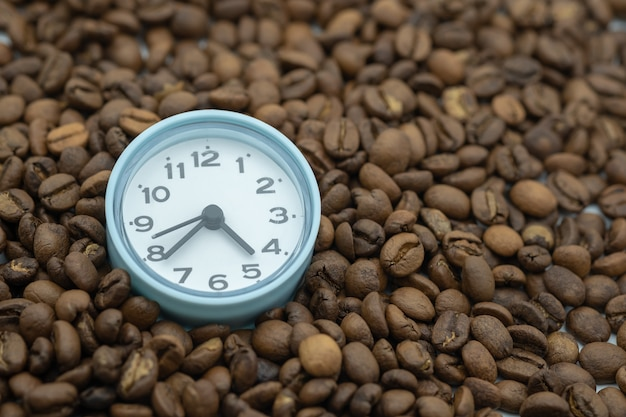 Close up of vintage round clock with coffee beans.