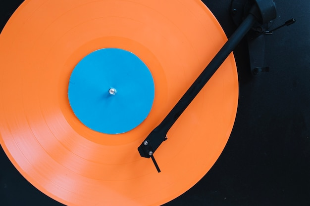 Close-up vinyl disc on record player
