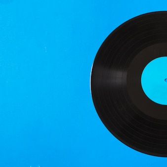 Close-up of vinyl record on blue background