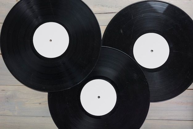 Close-up of vinyl records on wooden table