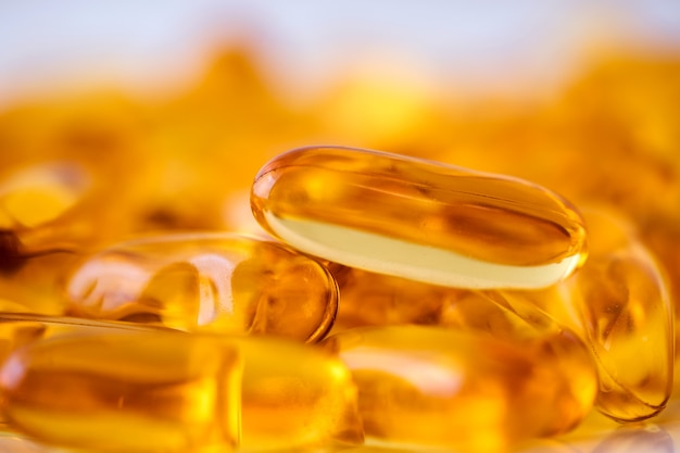 Close up the vitamin d and omega 3 fish oil capsules supplement