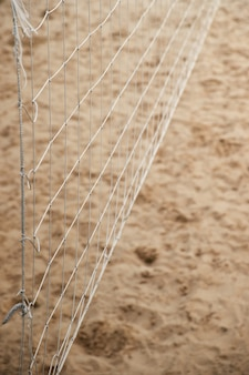 Close-up of voleyball net on the beach. summer outdoor activity. selective focus.