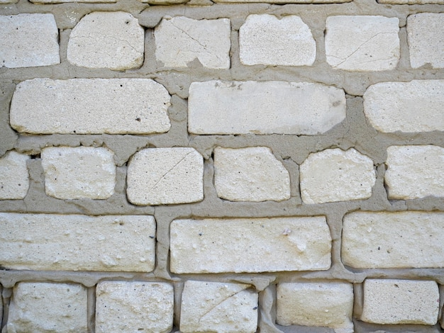 Close-up of a wall of white blocks. cement mix between blocks
