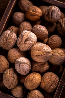 Close up walnuts in wooden box