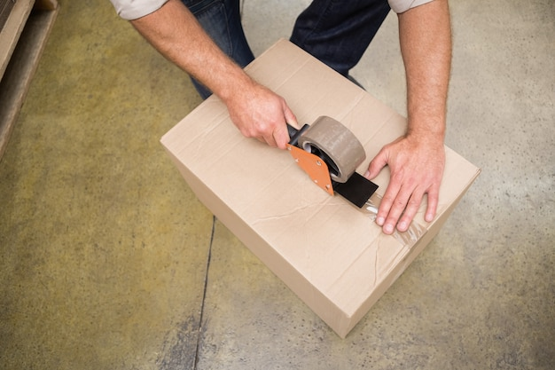 Close up of warehouse worker preparing a shipment