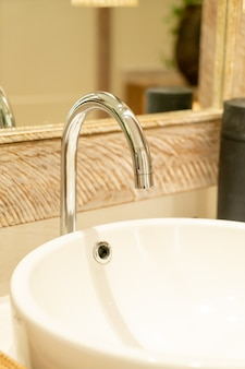 Close-up water faucet in bathroom