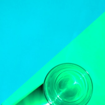 Close-up of a water glass on dual background