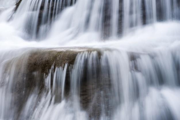 Close-up waterfall flowing fall on limestone