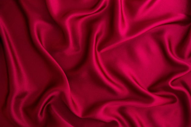 Close up wave red silk or satin fabric background