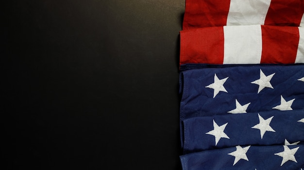 Close up of waving national usa american flag on black background with copy space for text.