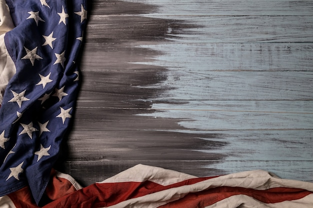 Close up of waving national usa american flag on wooden background with copy space for text.