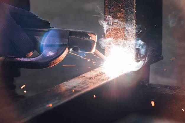Close-up of the welding process of two metal parts. industrial background.