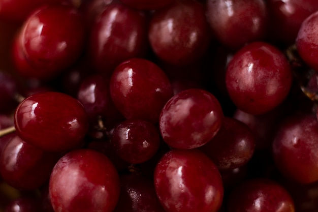 Close up wet red grapes