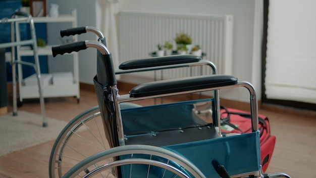 Close up of wheelchair in empty room at nursing home