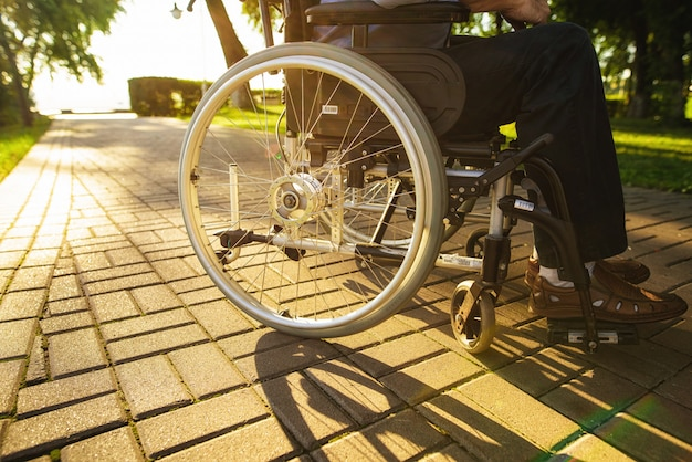 Close up. wheelchair wheel. disabled assistance.