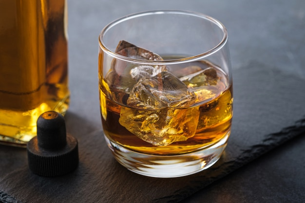 Close-up whiskey glass with cubes
