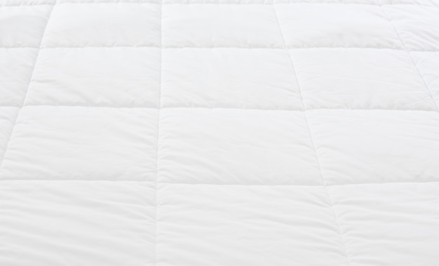 Close up of white bedding sheet pattern background