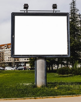 Close-up of white blank billboard with lamp