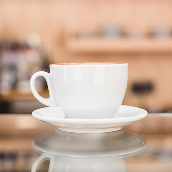 Close-up of white coffee cup in caf� shop