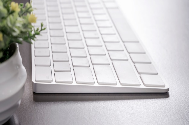 Close up of white computer keyboard on wooden  table