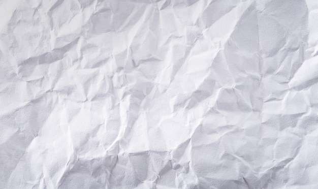 Close-up white crumpled paper texture background.