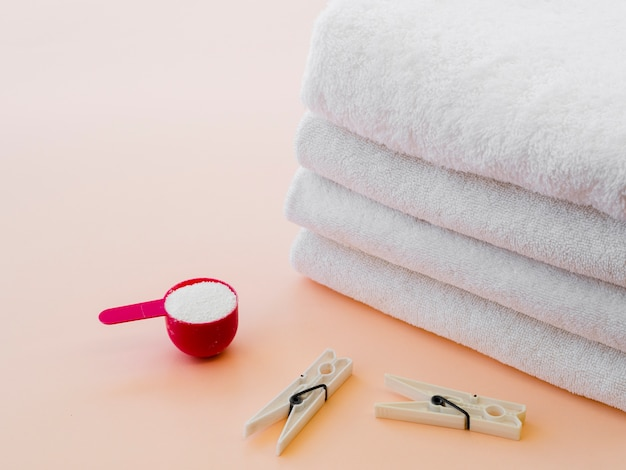 Close-up white folded clean towels with clothes pin