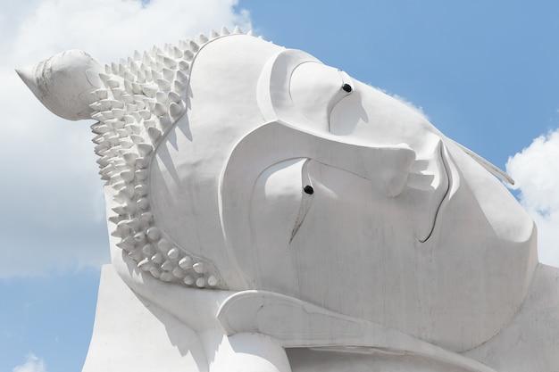 Close up white head buddha statue