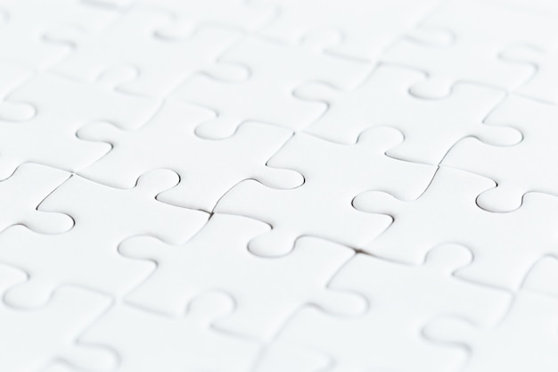 Close up white jigsaw game puzzle.