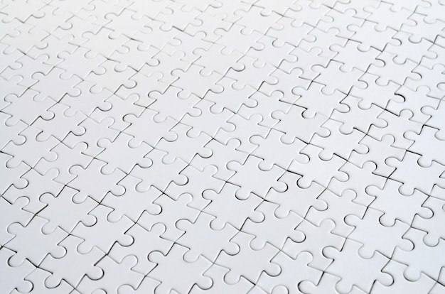 Close up of a white jigsaw puzzle in assembled state in perspective