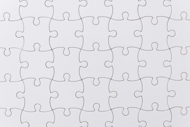Close up white jigsaw puzzle texture