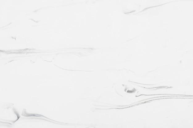 Chiuda in su di una parete strutturata di marmo bianca