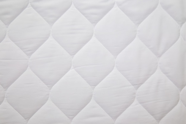 Close up of white mattress bedding pattern space