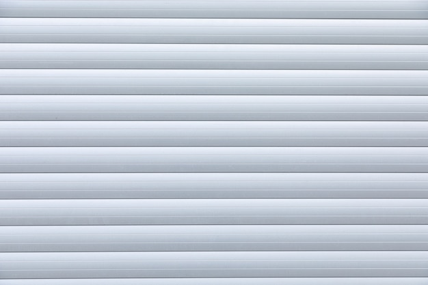 Close-up of white metal corrugated roller-shutter door