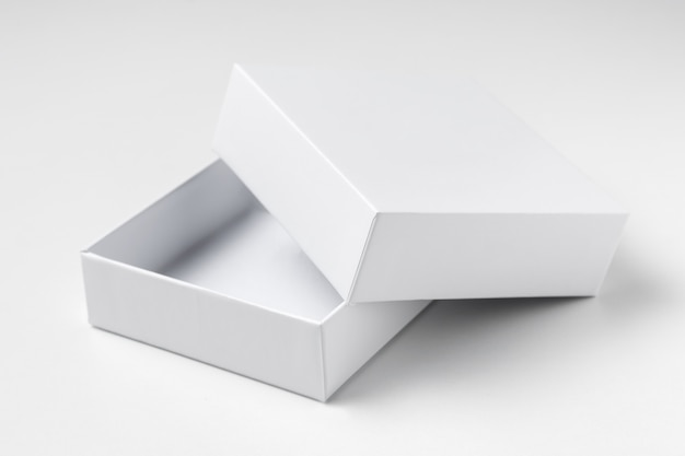 Close up white open cardboard gift box