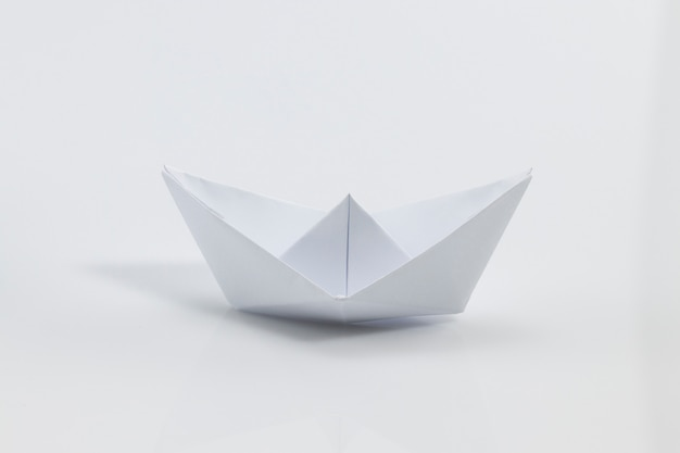 Close up of white origami ship isolated