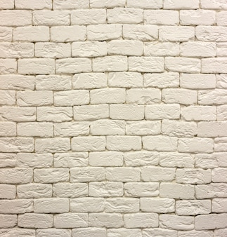 Close-up of white painted whitewashed solid brick wall. abstract copy space background, bricklaying, construction and masonry concept.