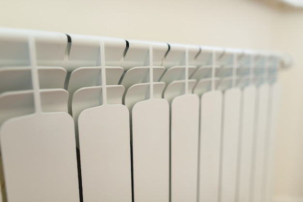 Close-up of white radiator heater in apartment.