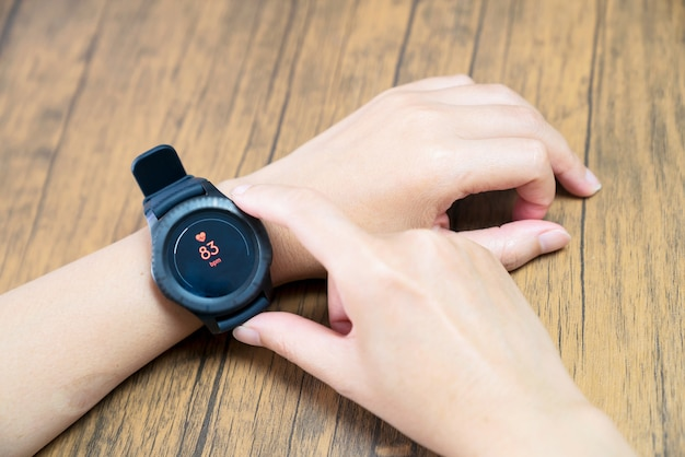 Close up white smart watch with health app icon on the screen