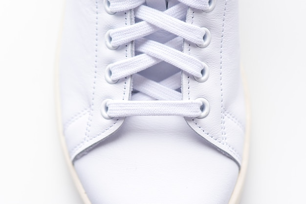 Close-up white sneakers, boot, shoe with shoelaces, sport shoes