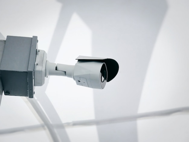 Close-up white surveillance camera for safety monitoring