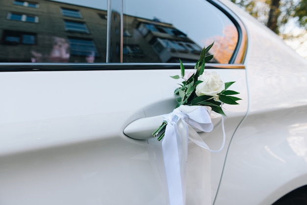Close-up of a white wedding car door