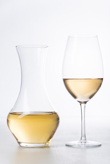 Close-up white wine glass and decanter