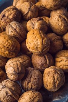 Close-up of whole walnut shells