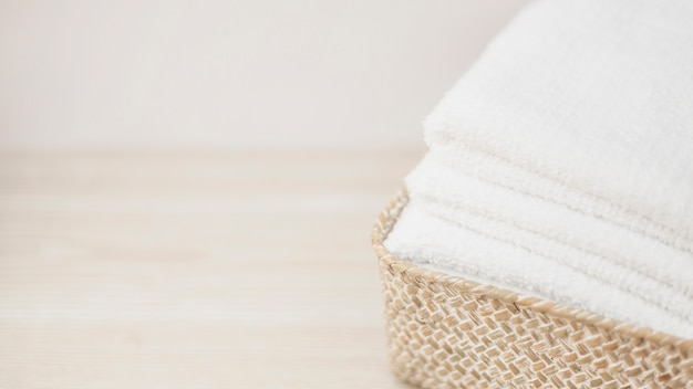 Close-up of wicker basket with stacked towels