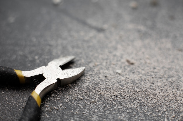 Close-up of a wire cutter a professional electrician installer tool.